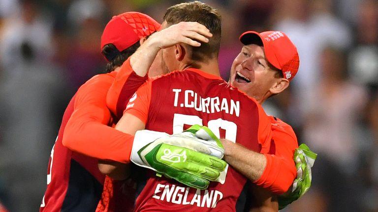 Eoin Morgan and Jos Buttler hug Tom Curran after England's win