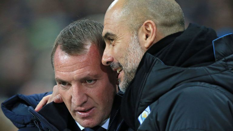 Pep Guardiola (R) chats with Leicester manager Brendan Rodgers (L)