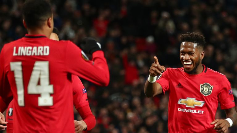 Fred celebrates with Jesse Lingard after his first goal