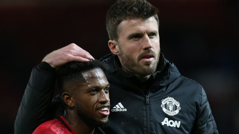 Manchester United midfielder Fred and assistant coach Michael Carrick