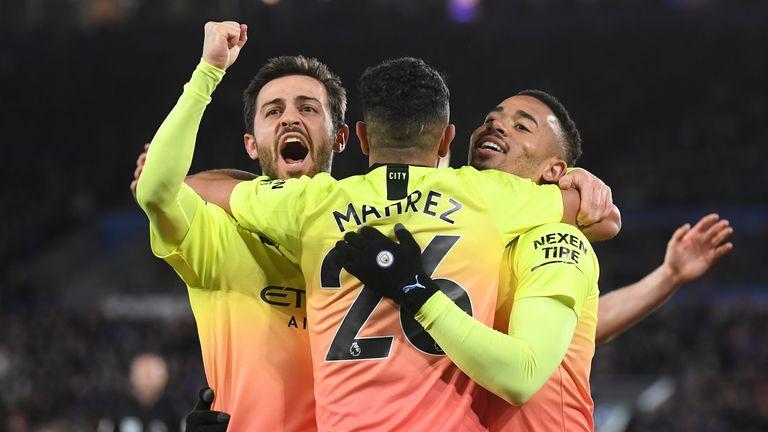 Gabriel Jesus celebrates with Riyad Mahrez and Bernardo Silva after scoring against Leicester City