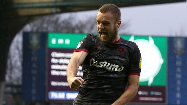 George Puscas of Reading FC celebrates after scoring his team's second goal against Sheffield Wednesday