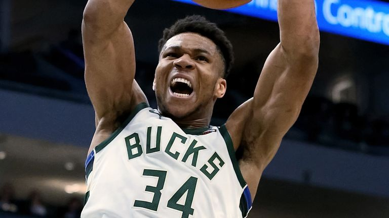 Giannis Antetokounmpo hammers home a dunk in Milwaukee's win over Phoenix
