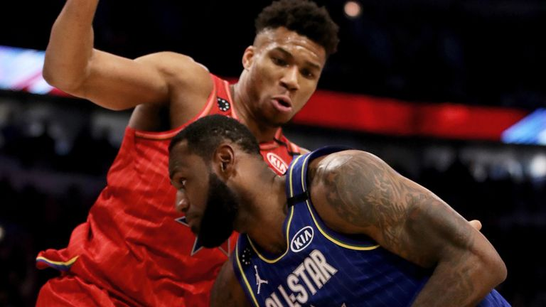 Giannis Antetokounmpo puts defensive pressure on LeBron James during the All-Star Game