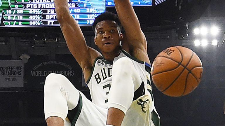 Giannis Antetokounmpo rocks the rim against the Philadelphia 76ers