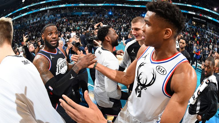 LeBron James of Team LeBron and Giannis Antetokounmpo of Team Giannis shake hands the 2019 NBA All-Star Game