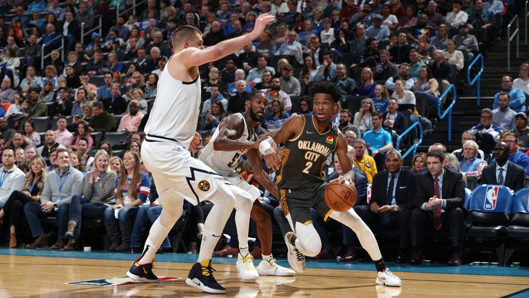 Shai Gilgeous-Alexander of the Oklahoma City Thunder drives to the basket against the Denver Nuggets