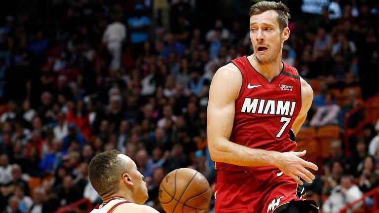 Goran Dragic of the Miami Heat throws a pass around Dante Exum of the Cleveland Cavaliers