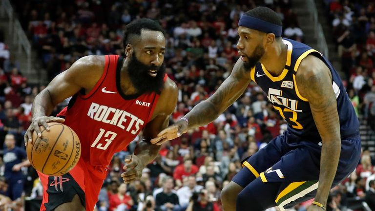 James Harden of the Houston Rockets drives to the basket defended by Royce O'Neale of the Utah Jazz