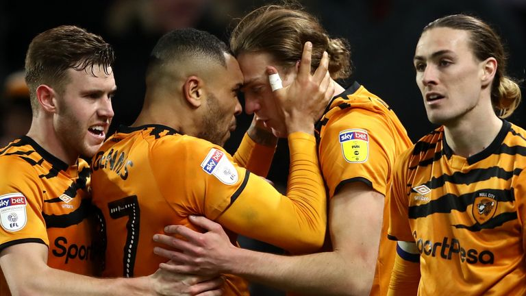 Hull City's Tom Eaves (centre right) celebrates scoring his side's fourth goal of the game vs Swansea with teammate Josh Magennis during the Sky Bet Championship match at the KCOM Stadium, Hull.