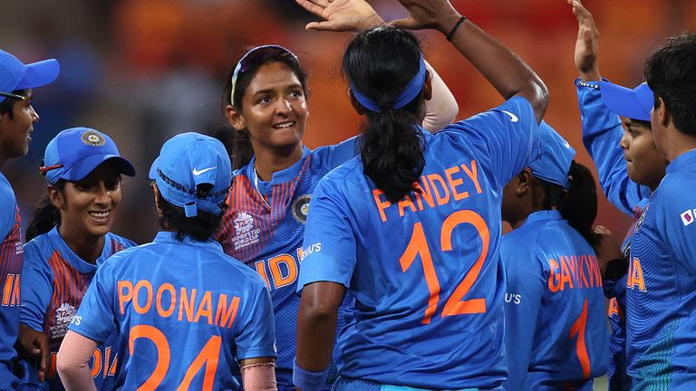 Harmanpreet Kaur celebrates with her India team after beating Australia in the ICC Women's T20 World Cup