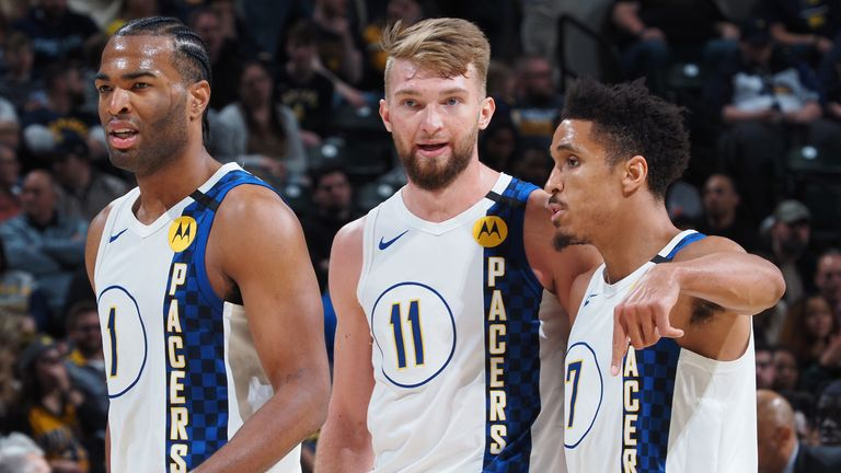 Domantas Sabonis shares a word with his Pacers team-mates