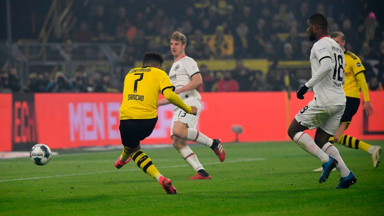 Sancho tucks in his shot to extend Dortmund's lead over Frankfurt