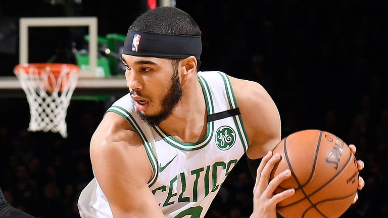 Jayson Tatum protects the ball against Orlando
