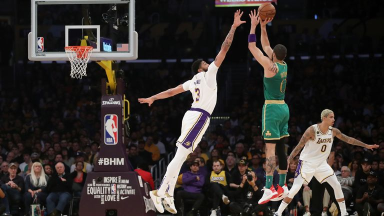 Jayson Tatum of the Boston Celtics shoots the ball against Anthony Davis of the Los Angeles Lakers