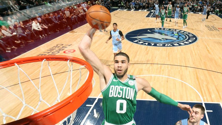 Jayson Tatum of the Boston Celtics shoots the ball against the Minnesota Timberwolves