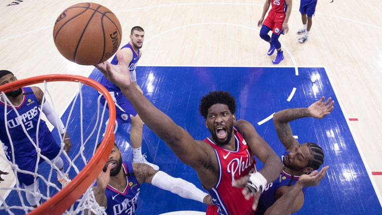 Joel Embiid of the Philadelphia 76ers shoots the ball against Kawhi Leonard of the Los Angeles Clippers