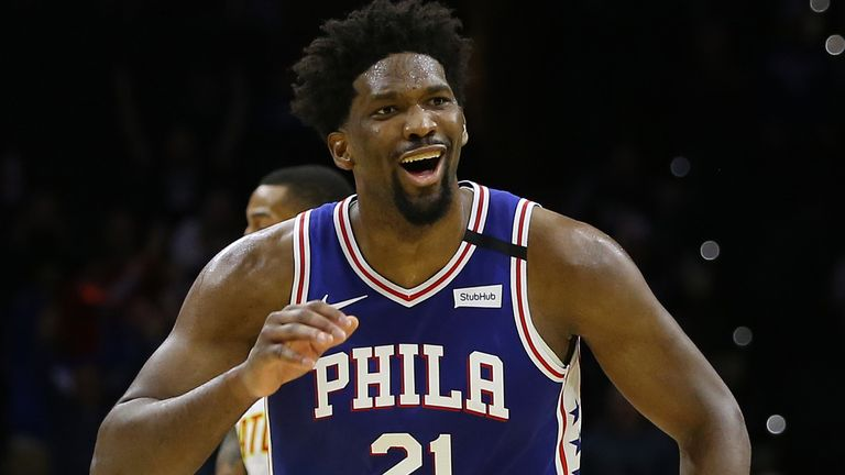 Joel Embiid celebrates a basket in the 76ers' win over the Hawks