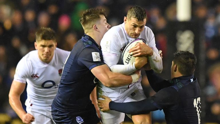 Jonny May is wrapped up by the Scotland defence