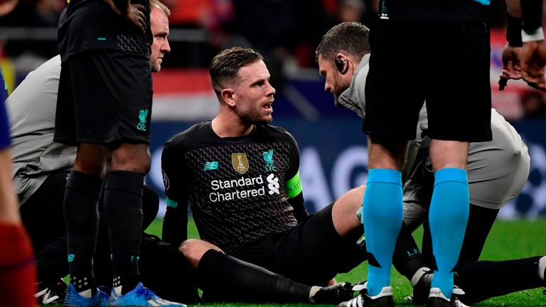 Jordan Henderson receives treatment before being subbed off in Madrid