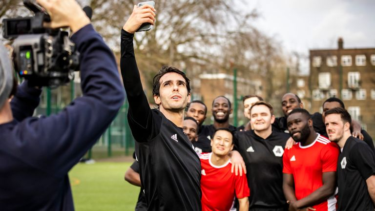 Kaka poses for a selfie with members of an east London football team as part of the adidas Rent-A-Pred campaign