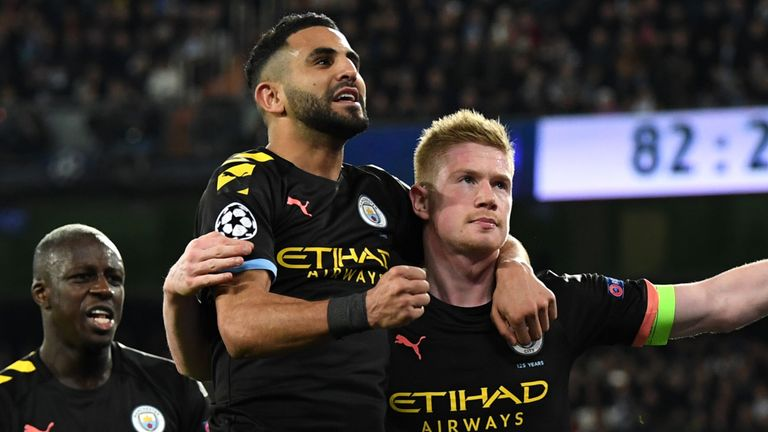 Man City's Kevin De Bruyne celebrates with team-mate Riyad Mahrez after his penalty against Real Madrid