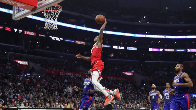 De'Aaron Fox of the Sacramento Kings dunks the ball during the second half against the LA Clippers