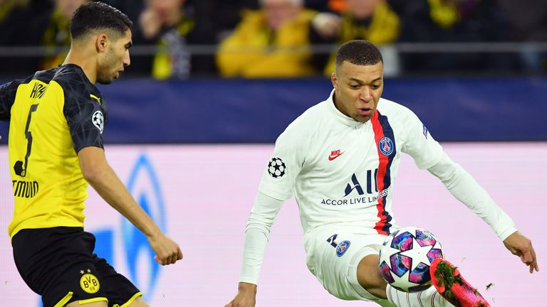 Kylian Mbappe looks to get through the Borussia Dortmund defence