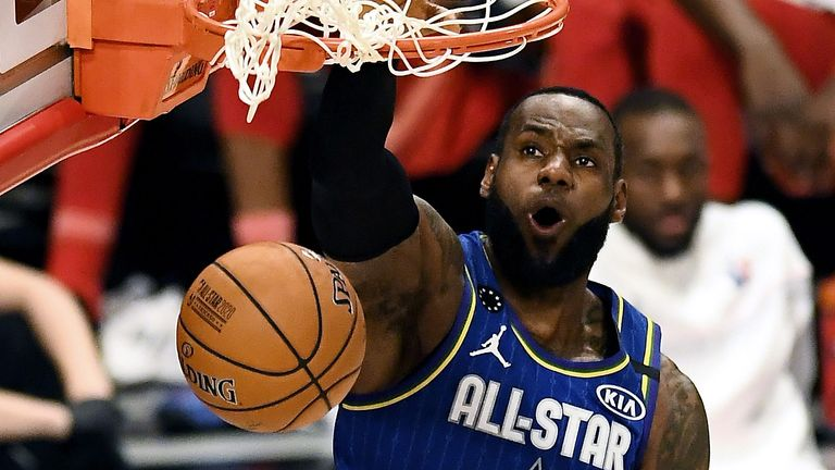 LeBron James rams home a dunk during the All-Star Game