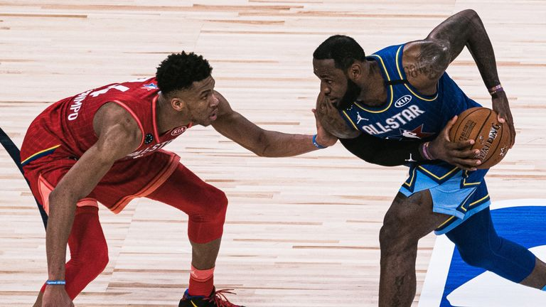 Giannis Antetokounmpo guards LeBron James during the All-Star Game