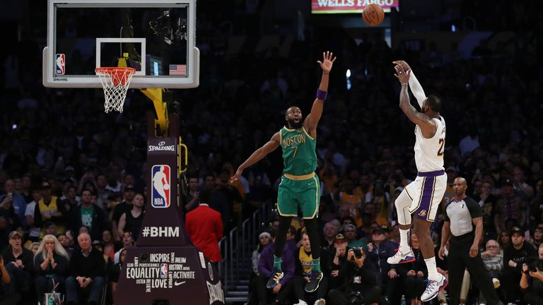 LeBron James of the Los Angeles Lakers shoots the ball against Jaylen Brown of the Boston Celtics