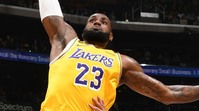 LeBron James rocks the rim with a huge dunk against the New Orleans Pelicans