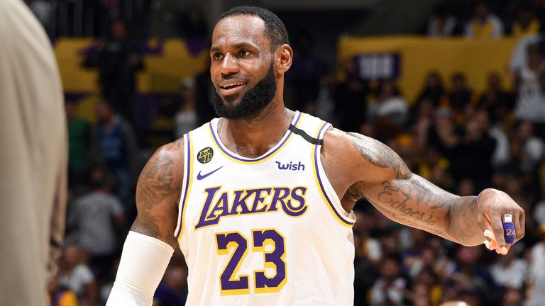 LeBron James celebrates after leading the Lakers to victory against the Celtics