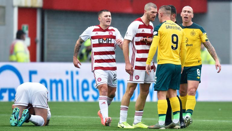 Leigh Griffiths and Alex Gogic square up with Sam Woods prone on the floor