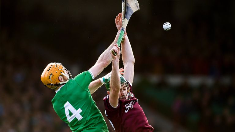 Richie English of Limerick and Brian Concannon of Galway compete for possession