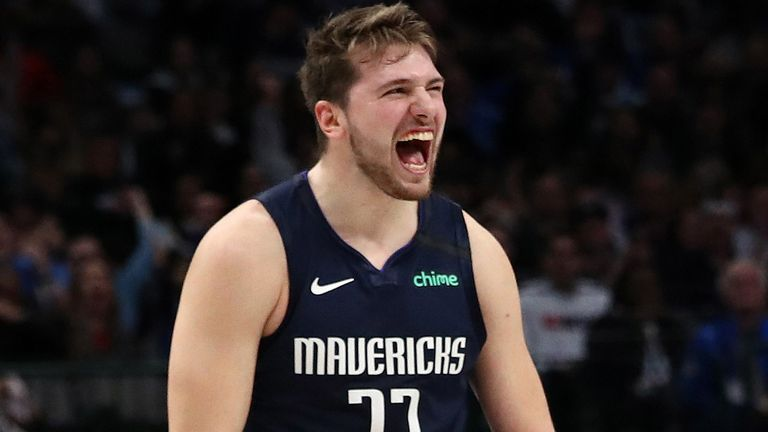 Luka Doncic roars in celebration during the Mavericks' win over the Kings