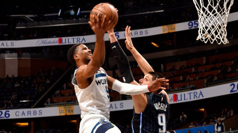 Malik Beasley of the Minnesota Timberwolves drives to the basket during the game against the Orlando Magic