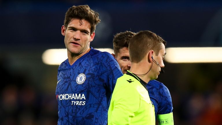 Referee Clement Turpin sends off Marcos Alonso of Chelsea