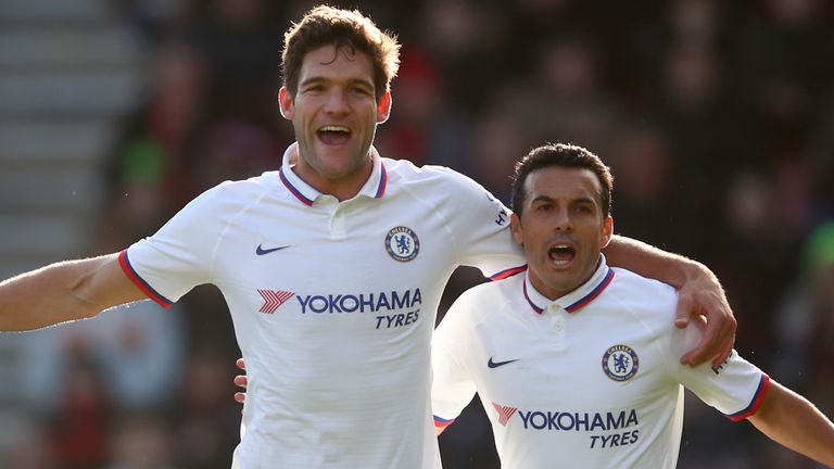 Marcos Alonso celebrates with team-mate Pedro after scoring against Bournemouth