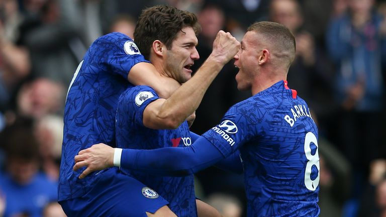 Marcos Alonso celebrates scoring Chelsea's second goal with Ross Barkley