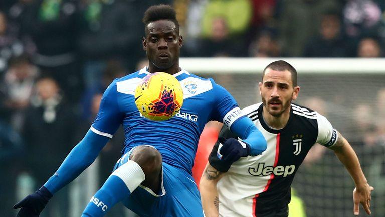 Brescia's Mario Balotelli challenges Juventus defender Leonardo Bonucci