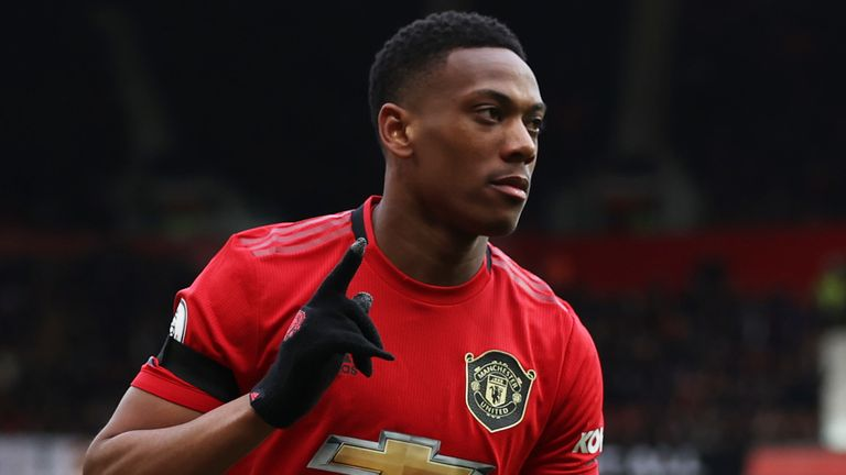 Anthony Martial of Manchester United celebrates after scoring his team's second goal during the Premier League match between Manchester United and Watford FC