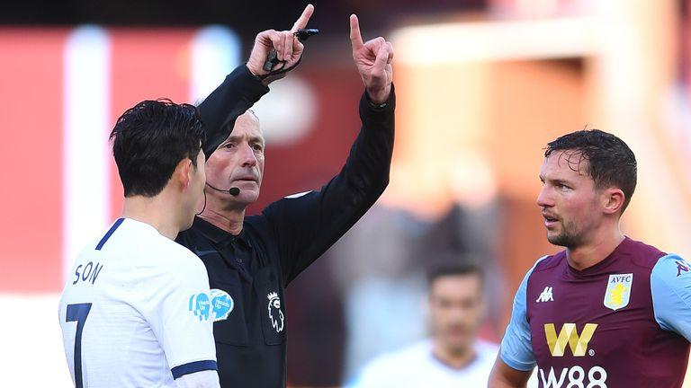 Referee Martin Atkinson awards Tottenham a penalty on the stroke of half-time
