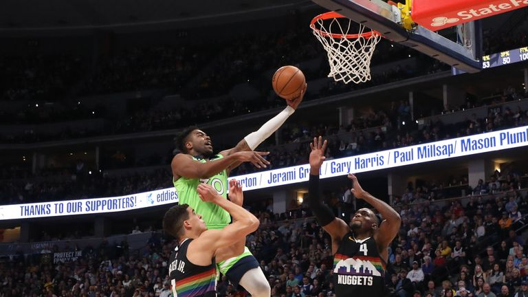 Kelan Martin of the Minnesota Timberwolves drives to the basket against the Denver Nuggets