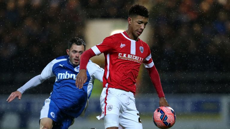 Holgate in action for Barnsley as an 18-year-old in December 2014