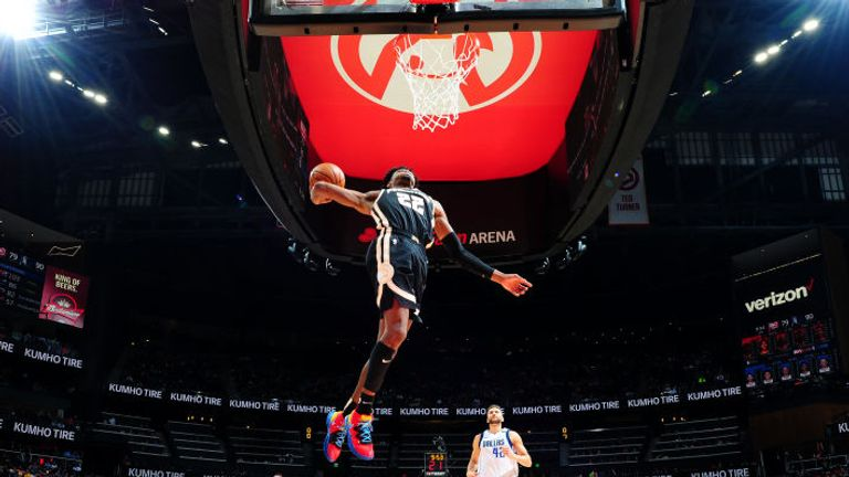 Cam Reddish of the Atlanta Hawks dunks the ball against the Dallas Mavericks