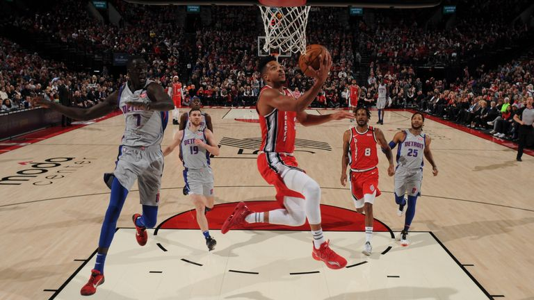CJ McCollum of the Portland Trail Blazers drives to the basket during a game against the Detroit Pistons