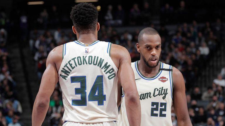 Giannis Antetokounmpo and Khris Middleton of the Milwaukee Bucks face the Sacramento Kings