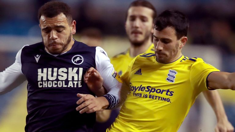 Millwall's Mason Bennett and Birmingham City's Maxime Colin (right) battle for the ball