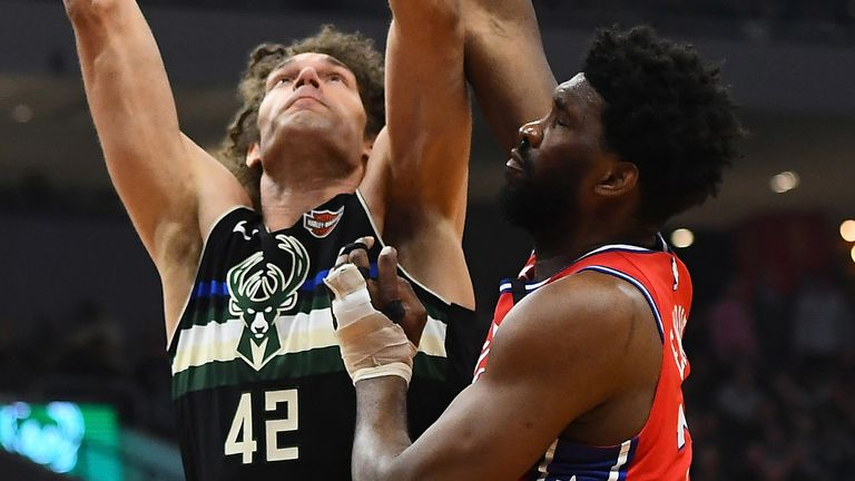 Robin Lopez is challenged at the rim by Joel Embiid